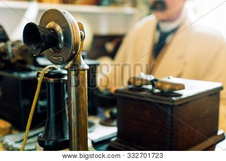 Old Vintage Antique Candlestick Telephone On The Business Working Table Working On The Past. Candle