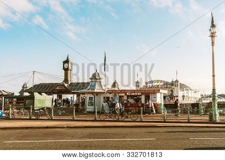 Brighton, England - October 3, 2018: The Entrance Front Way Of Brighton Palace Pier With Local Peopl