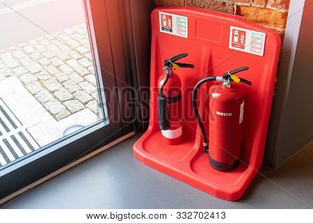 Two Red Tank Of Fire Extinguisher Water And Co2 (carbon Dioxide) Service On The Floor In Office, Sch