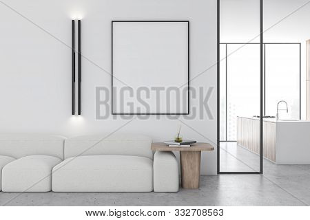 Interior Of Minimalistic Living Room With White Walls, Stone Floor, Comfortable White Sofa With Vert