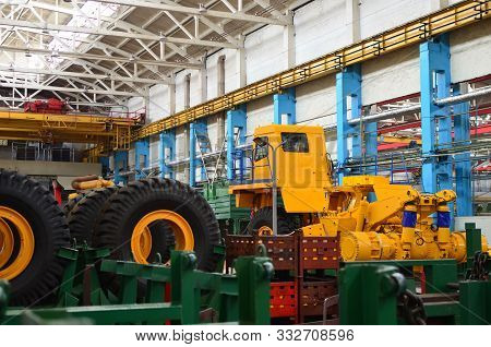 Production Process Of Heavy Mining Trucks At The Factory. Dump Truck On The Industrial Conveyor In T