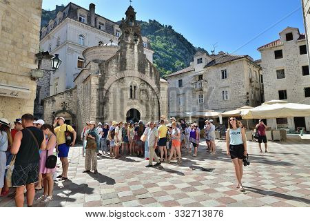 Kotor, Montenegro - June 10. 2019. Group Of Tourists Near The Church Of St. Luke In The Old Town Squ
