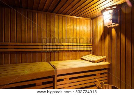 Interior Of Finnish Sauna, Classic Wooden Sauna, Finnish Bathroom, Relax In Hot Sauna With Steam.