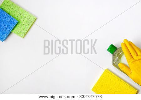 Cleaning Service Concept. Cleaning Set With Green Tools On White Background. Top View Cleaning Acces