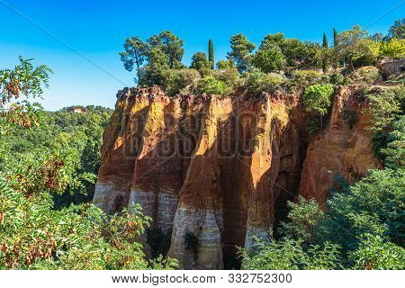 Roussillon, Red Rocks Of Colorful Ochre Canyon In Provence