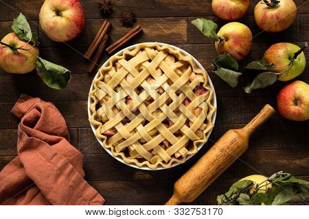 Apple Pie With Lattice Top On Wooden Background, Table Top View. Rustic American Apple Pie