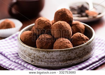 Chocolate Truffles In Ceramic Dish On Table. Homemade Chocolate Candy Truffles