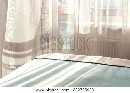 Light Through The Window In The Bedroom, Shade Through A Transparent Curtain On The Blanket Tucked I