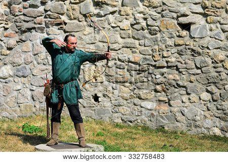 Drobeta Turnu Severin, Romania - 08.31.2019: Medieval Archer Man At Archery Contest With Fortress Wa