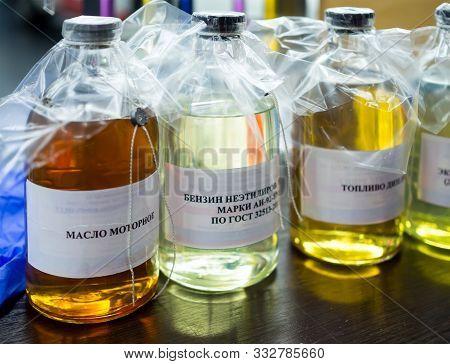 Automotive Fuel And Engine Oil Sample Bottles. Translation Of The Inscription