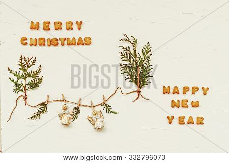 Words Merry Christmas And Happy New Year Made Of Cookie Letters. Flat Lay Composition With Green Pla