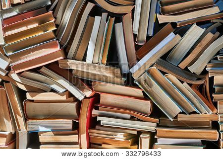 Pile of old books in dramatic dim light
