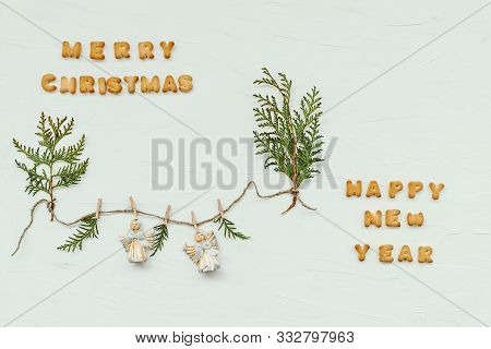The Words Merry Christmas And Happy New Year Are Made Of Cookie Letters. Flat Lay Composition With G