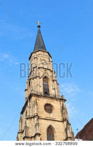 Tower Of St Michael Catholic Church Against Blue Sky In Cluj-napoca City Center, Transylvania