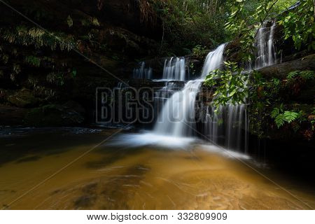 Lush Waterfall Surrounded By Ferns In Blue Mountains Australia