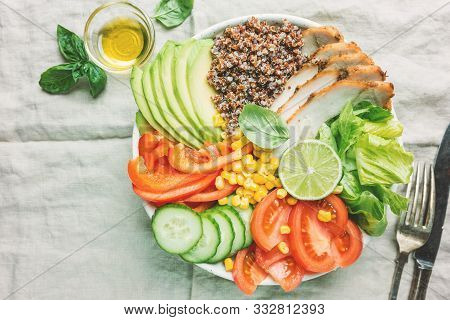 Healthy Salad Bowl With Quinoa, Tomato Turkey, Avocado, Sweet Pepper, Corn, Lime And Mixed Greens, T