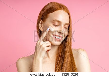 Portrait Of Cheerful Beauty Model With Naked Body, Applying Anti-aging, Revitalizing Face Cream, Smi