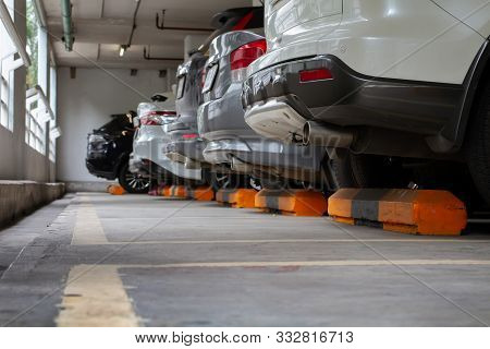Cars Parked In A Line Arranged In An Orderly Manner. Parking In A Well-covered Indoor Parking Lot To