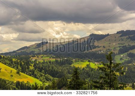 Ukraine, Carpathians. View Of The Verkhovyna Village From The Lookout Mountain Shveykova
