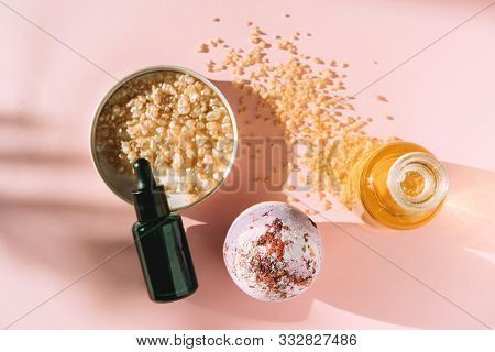 Beauty Products With Bottle With Oil, Bath Bomb And Salth On A Pink Background. The Concept Of Natur