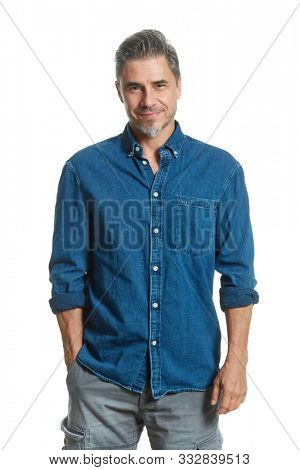 Casual older white man isolated on white, smiling.