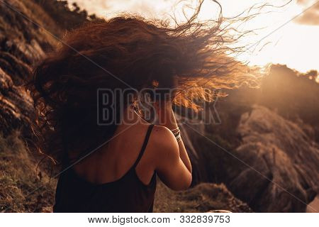 Beautiful Young Woman Portrait At Sunset On The Top Of Mountain
