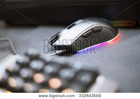 Close Up Of Computer Rgb Gaming Mouse, Illuminated By Colored Led