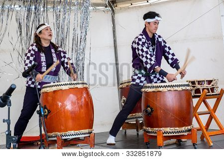 Melbourne, Australia - October 6, 2019: Male And Female Taiko Drummers During Live Performance