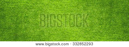 The Artificial Green Grass Pattern Texture Background.