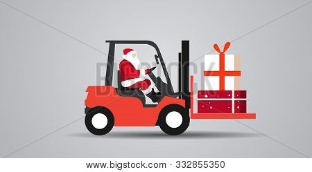 Santa Claus Driving Forklift Truck Loading Colorful Gift Present Boxes Delivery And Shipping Concept