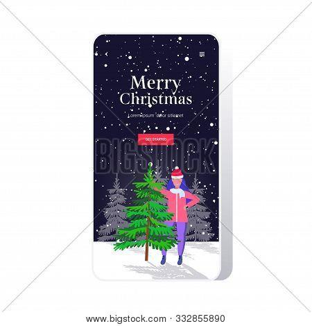 Woman Wearing Santa Claus Hat Standing Near Fir Tree Happy Hew Year Merry Christmas Winter Holidays