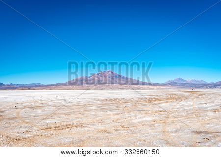 Desierto De Siloli Is A High Mountain Desert With Volcanoes On The Horizon And Clear Blue Skies Make