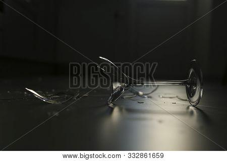 Broken Wine Glass Lying On The Floor
