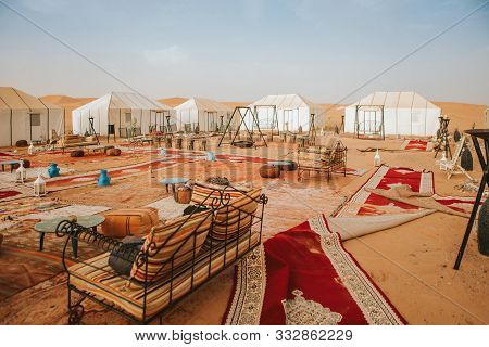 Beautiful Desert Camp Courtyard At Sunset, With Carpets And Seats To Chill.