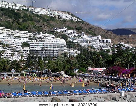 Scenic view of tourist village of Puerto Rico on island of Gran Canaria.