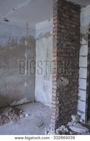 Redevelopment Of Old Rooms. Home Repairs. Industrial Vertical Background. Nobody Room With A Window