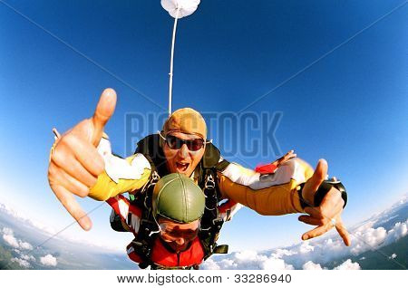 Tandem skydiver in action parachuting.