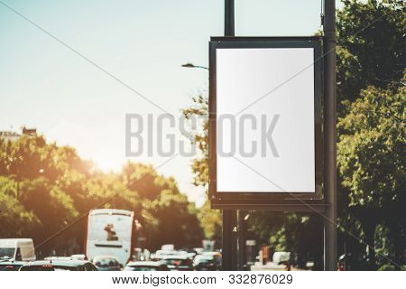 Mock-up Of An Empty Advertising Banner Over A Highway; A Blank Vertical Street Poster Template On In