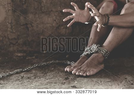 Handcuffed Hands Of A Prisoner In Prison,   Male Prisoners Were Severely Strained In The Dark Prison