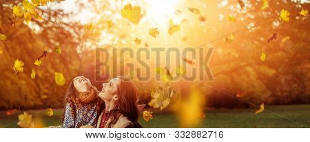 Happy mother and daughter in the autumn park