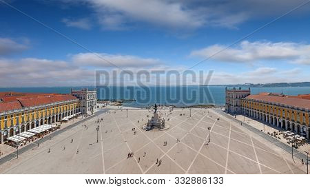 Lisbon, Portugal. Aerial view of Praca do Comercio aka Terreiro do Paco or Commerce Square with King Dom Jose statue, Cais das Colunas Wharf and Tagus or Tejo River estuary
