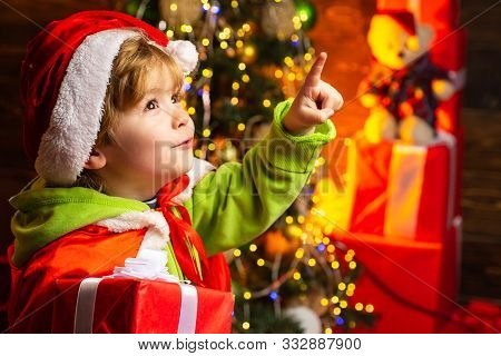Boy Cute Child Cheerful Mood Play Near Christmas Tree. Gifts For Winter Holidays Near Fire Place. Ch