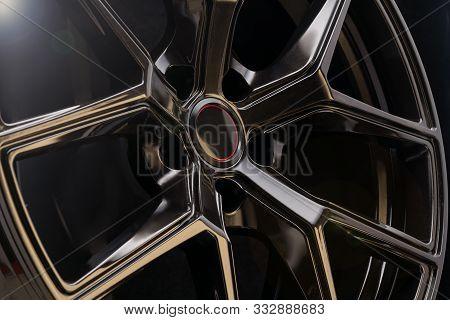 Cool Black Aluminum Die-cast Car Wheel On Dark Background, Lightweight Forged Alloy Wheels. Fashiona