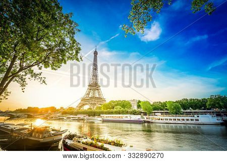 Paris Eiffel Tower And Famous River Seine At Sunrise In Paris, France. Eiffel Tower Is One Of The Mo