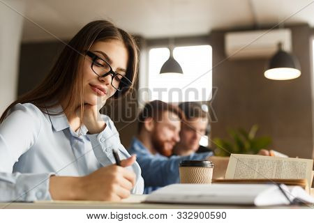Smart Girl Student Studying At Library, Writing Essay And Drinking Coffee, Free Space