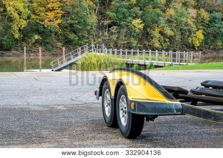 trailer, dock and boat ramp on Tennessee River in fall scenery,  Colbert Ferry along Natchez Trace Parkway, travel and recreation concept