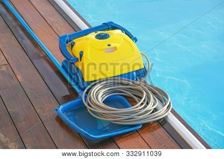 Pool Cleaner During His Work. Cleaning Robot For Cleaning The Botton Of Swimming Pools. Automatic Po