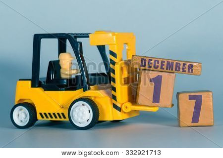 December 17th. Day 17 Of Month, Construction Or Warehouse Calendar. Yellow Toy Forklift Load Wood Cu