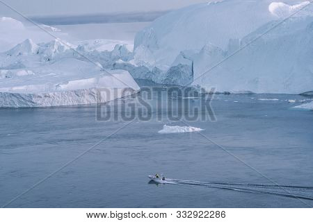 Icebergs And Tourist Fishing Boat In Greenland Iceberg Landscape Of Ilulissat Icefjord With Giant Ic