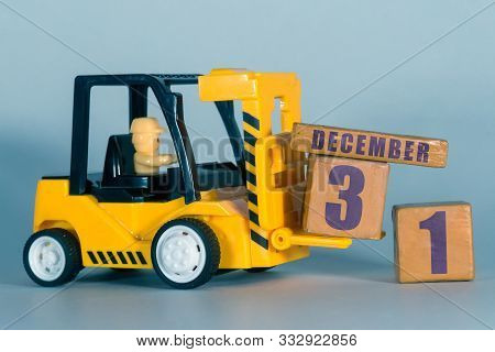 December 31st. Day 31of Month, Construction Or Warehouse Calendar. Yellow Toy Forklift Load Wood Cub